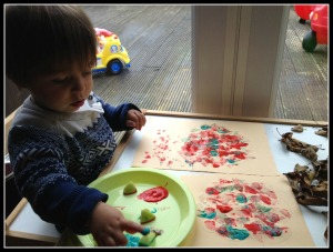 Autumn craft activity. Painting with apples and leaves